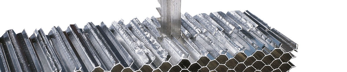 picture of sawing material on a doall vertical sawing machine
